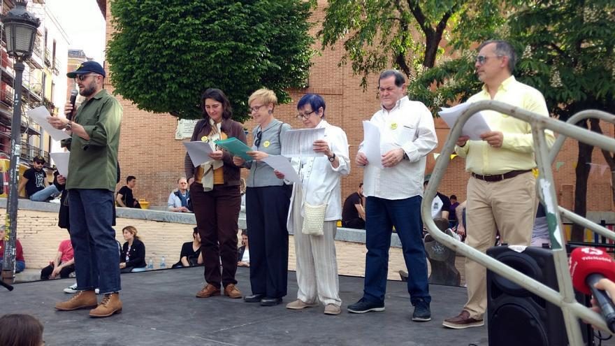 Miembros de SOS Malasaña, durante el pregón anunciador de fiestas | SOMOS MALASAÑA