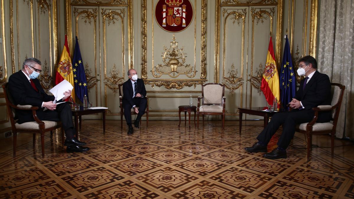 Alberto Ruiz Gallardón, Juan Carlos Campo y Rafael Catalá, durante el coloquio.