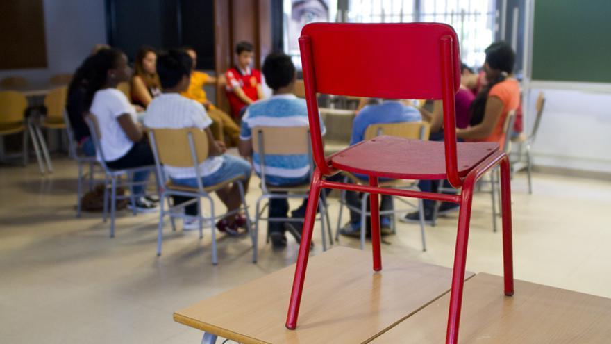La silla roja, símbolo de la campaña de Entreculturas/ Fotografía: Javier Urrecha, Entreculturas.