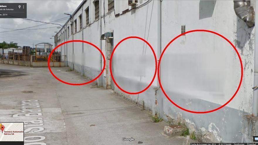 Grafitis difuminados en la parte trasera de la fábrica de Tenneco, en Gijón