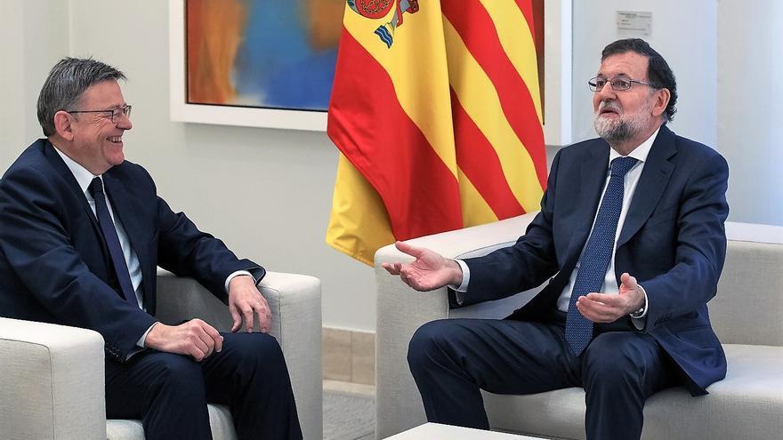 El president Ximo Puig dialoga con Mariano Rajoy en la Moncloa