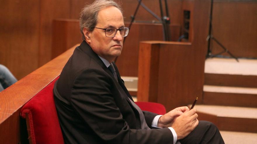 Torra admite que desoyó a la Junta Electoral y no retiró los lazos amarillos