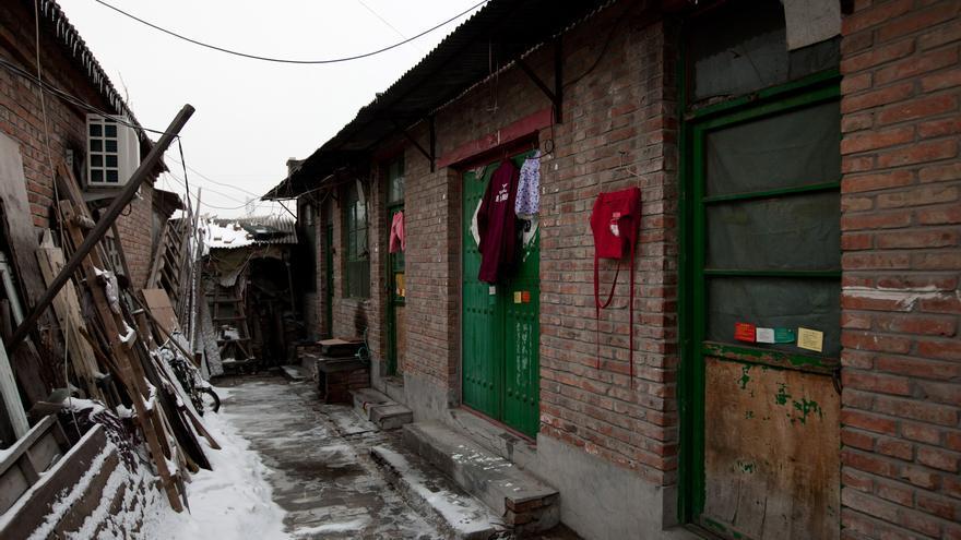 """Albergues reconvertidos en prisiones, las """"cárceles negras"""" de Beijing. (AP Photo / Andy Wong)"""