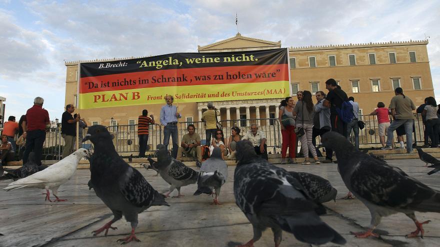 Merkel viaja a Grecia para apoyar a Samarás en medio de una gran tensión social