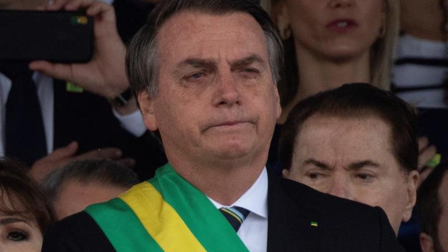 Bolsonaro reasumirá mañana la Presidencia y dice que sancionará una ley sobre armas