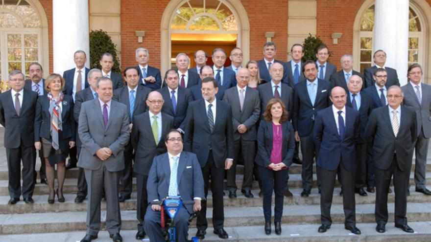 Crespo, ante Montoro y Rajoy en un acto con empresarios en La Moncloa