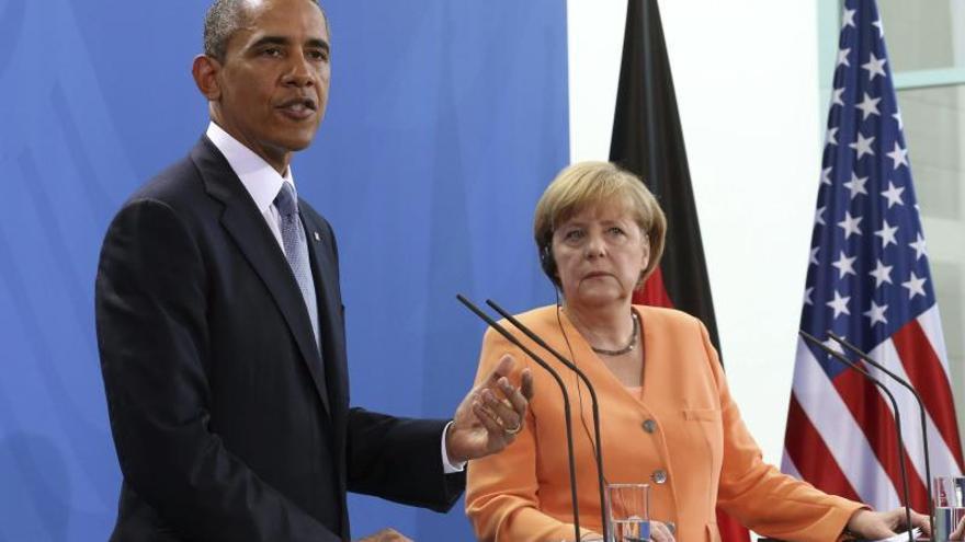 Obama dice que mientras él sea presidente EEUU no volverá a espiar a Merkel