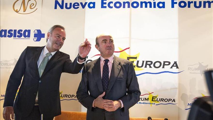 """De Guindos, convencido de que Bankia devolverá """"muchísimas"""" ayudas públicas"""