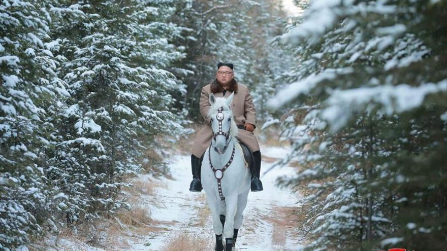 North Korean leader Kim Jong-un rides white horse through snowfall on Paektu Mountain