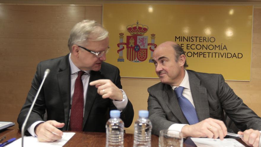 (Amp) Rehn pide a España políticas que completen reforma laboral y Guindos responde que hará lo imprescindible