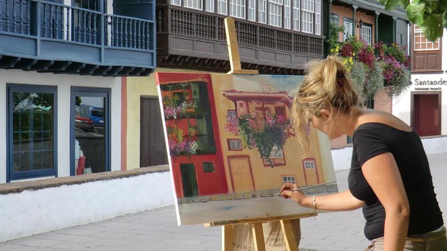 En la imagen, una pintora en una edición anterior del certamen.