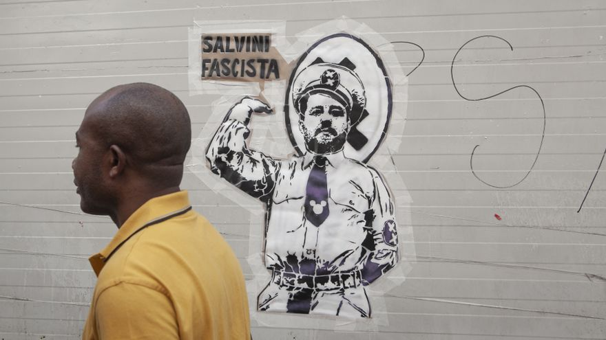 August 28, 2018 - Milan, MI, Italy - A man seen walking past a graffiti during the protest..Left-wing activists protest against the meeting of the Italian Deputy Premier and Interior Minister, Matteo Salvini, and the Hungarian Premier, Viktor Orbán. Protestors refuse both common populist vision and anti-migrants' stances.