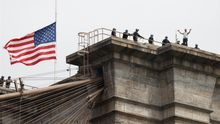 New York City Police officers talk to a man who climbed atop the Brooklyn Bridge in Brooklyn, New York, USA, 22 May 2020.