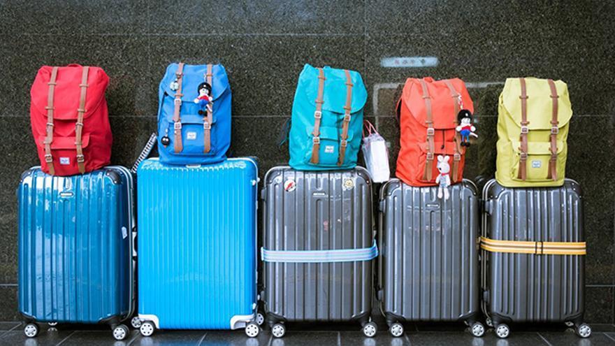 la maleta de man incluye un bolso