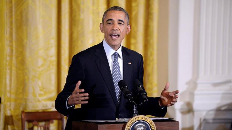 Obama defiende la reforma de Wall Street junto a influyente senadora progresista