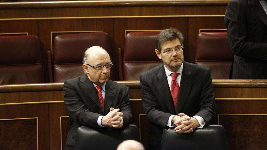 Los ministros de Hacienda y Justicia