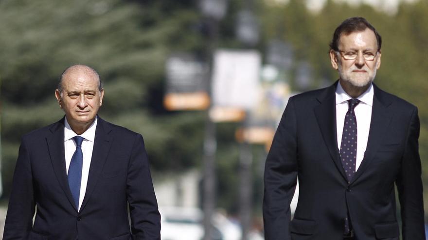 Jorge Fernández Díaz y Mariano Rajoy en una fotografía de archivo