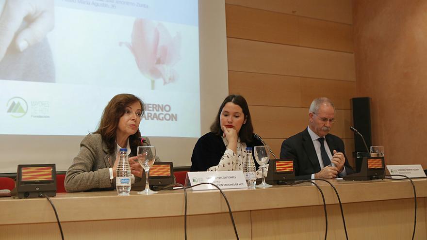 En el centro la directora general del IAM, Natalia Salvo.