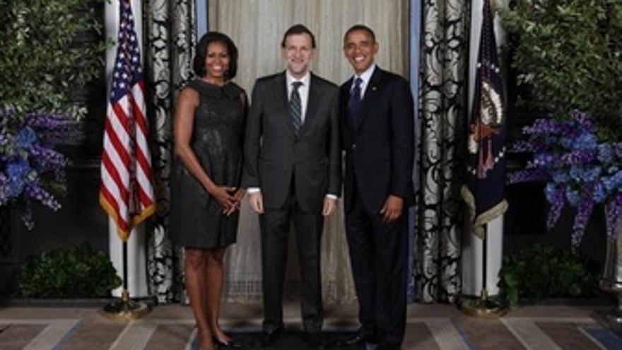 Rajoy con el matrimonio Obama