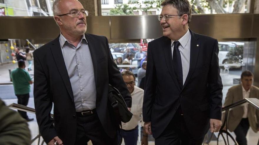 El president Ximo Puig junto al secretario general de Podem, Antonio Montiel