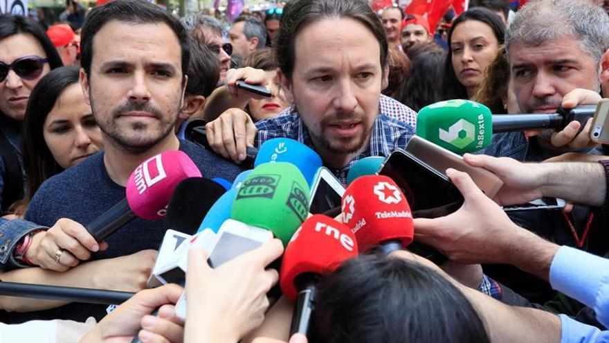 Garzón e Iglesias piden gobernar en coalición para defender al trabajador