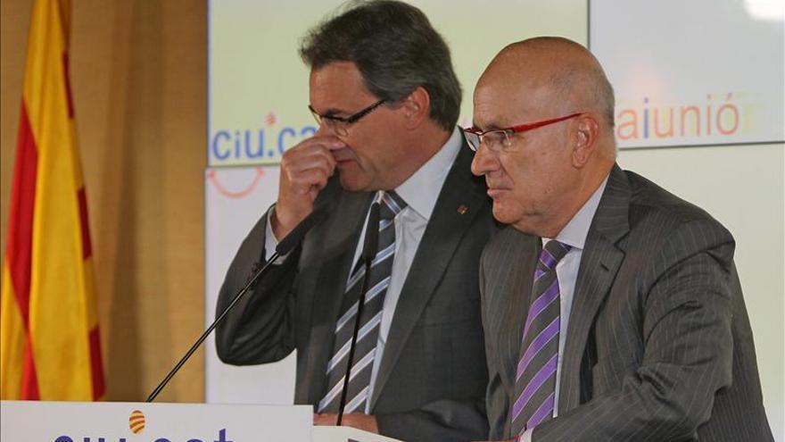 Artur Mas y Duran i Lleida, en la sede de CiU