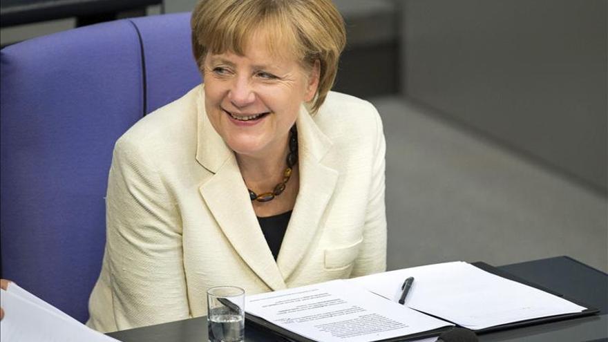 Merkel pone a España como ejemplo de que la política de reformas funciona