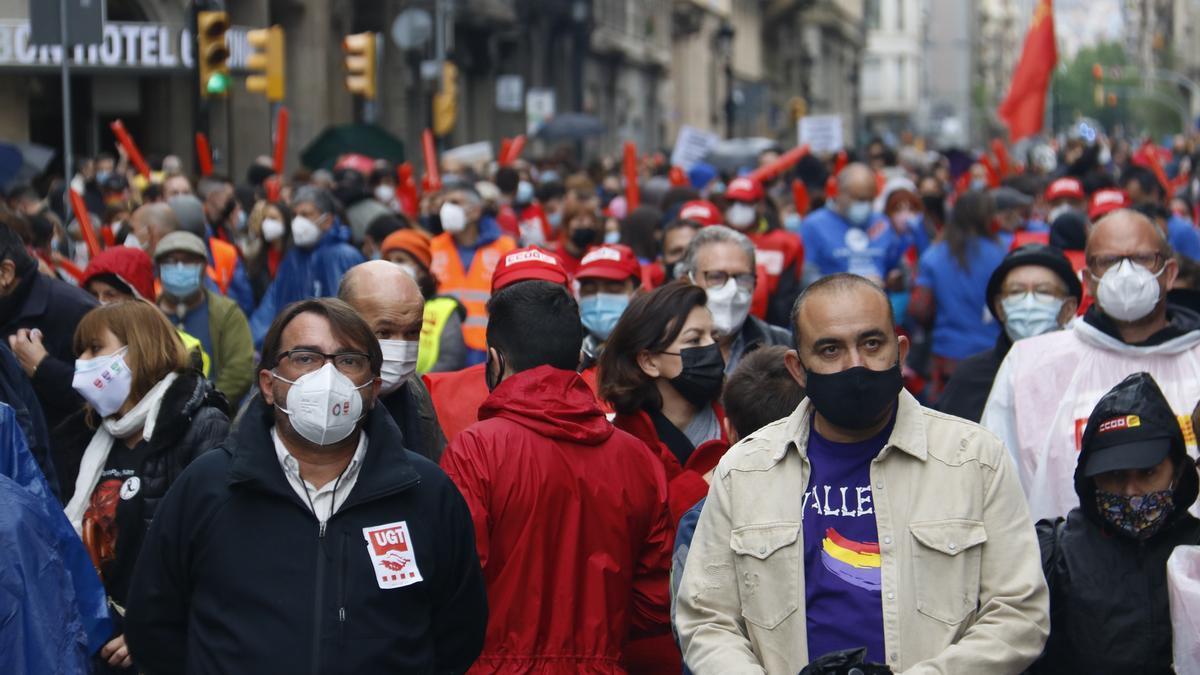 Los dirigentes de UGT y CCOO, en la manifestación en Via Laietana