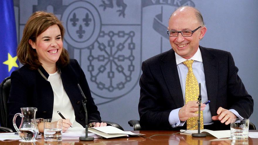 Soraya Sáenz de Santamaría y Cristóbal Montoro, en una imagen de archivo. Foto: Pool Moncloa