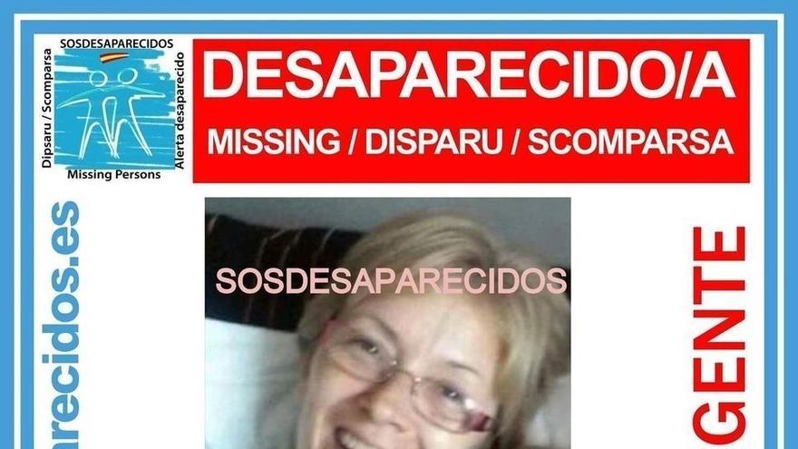 Cartel de búsqueda, con un retrato de la desaparecida
