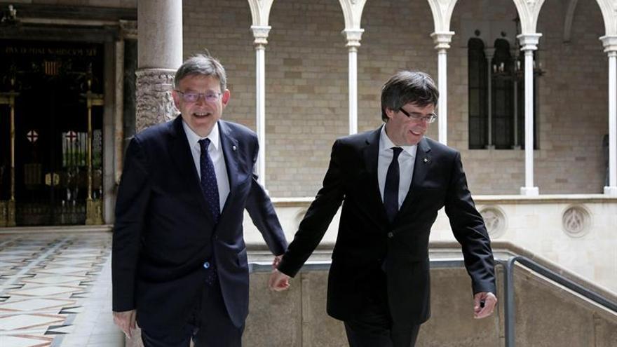 Puigdemont y Puig acuerdan reclamar conjuntamente asuntos de interés mutuo