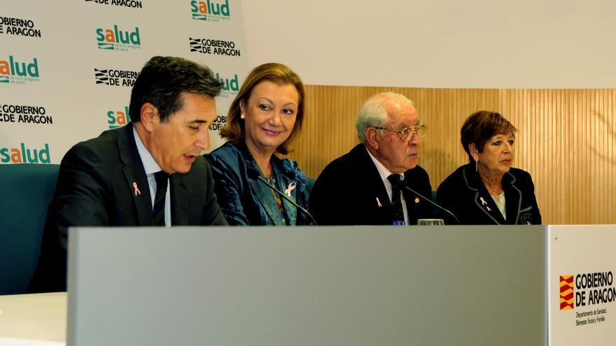 La expresidenta, Luisa Fernanda Rudi, con su consejero de Sanidad, Ricardo Oliván, a la derecha.