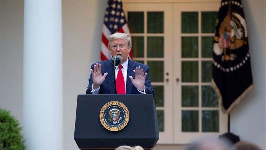 US President Donald J. Trump delivers remarks during a news conference in the Rose Garden of the White House in Washington, DC, USA, 14 April 2020. Trump announced that he has instructed his administration to halt funding to WHO, the World Health Organization.