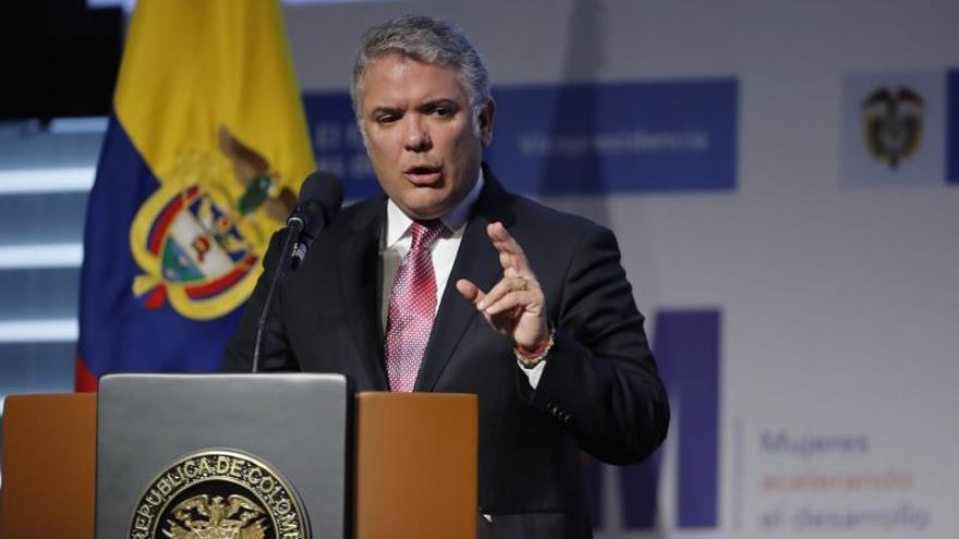 """En la imagen el presidente de Colombia Iván Duque habla durante el foro """"Empoderamiento Económico de la Mujer"""",en Bogotá (Colombia).."""