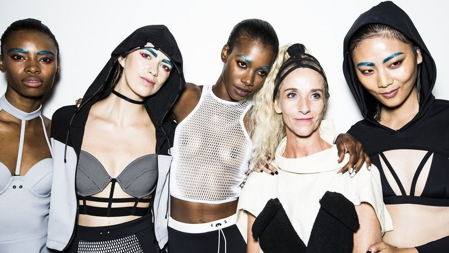 NEW YORK, NY - SEPTEMBER 11:  Models pose for a photo with a member of the team backstage during the Chromat Featuring Intel Collaboration show at Milk Studios on September 11, 2015 in New York City.  (Photo by Daniel C Sims/Getty Images for Chromat)