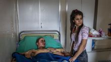 Injured Kurdish Fighter Receives Hospital Visit © Ivor Prickett, Ireland, for The New York Times