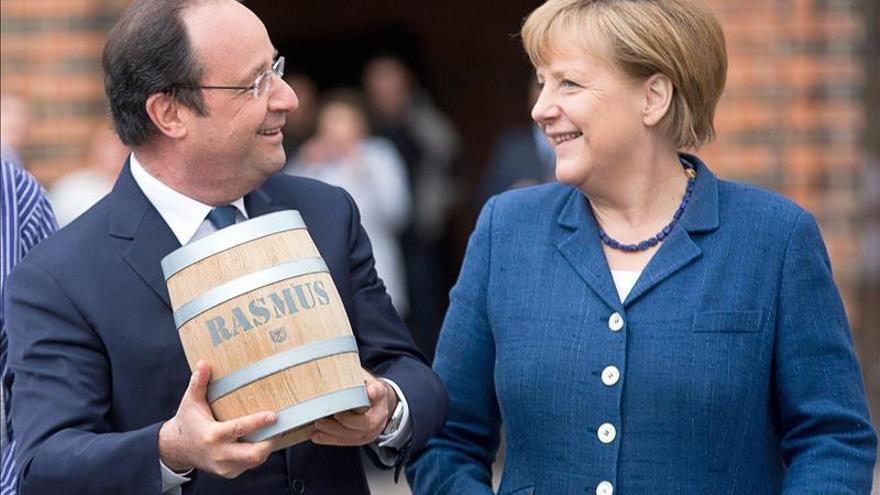 Merkel y Hollande ligan el voto en Ucrania con sanciones económicas a Rusia