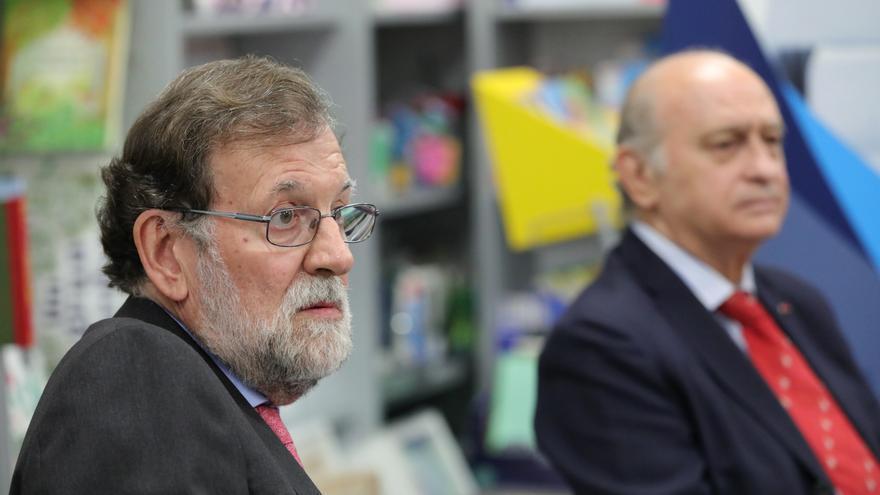 Archivo - El expresidente del Gobierno Mariano Rajoy, y el exministro de Interior Jorge Fernández Díaz