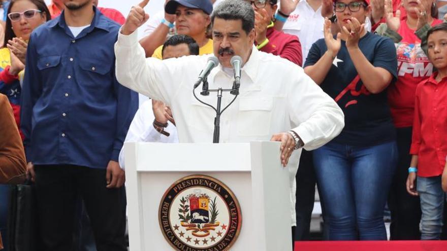 En la imagen el presidente de Venezuela, Nicolás Maduro (c).