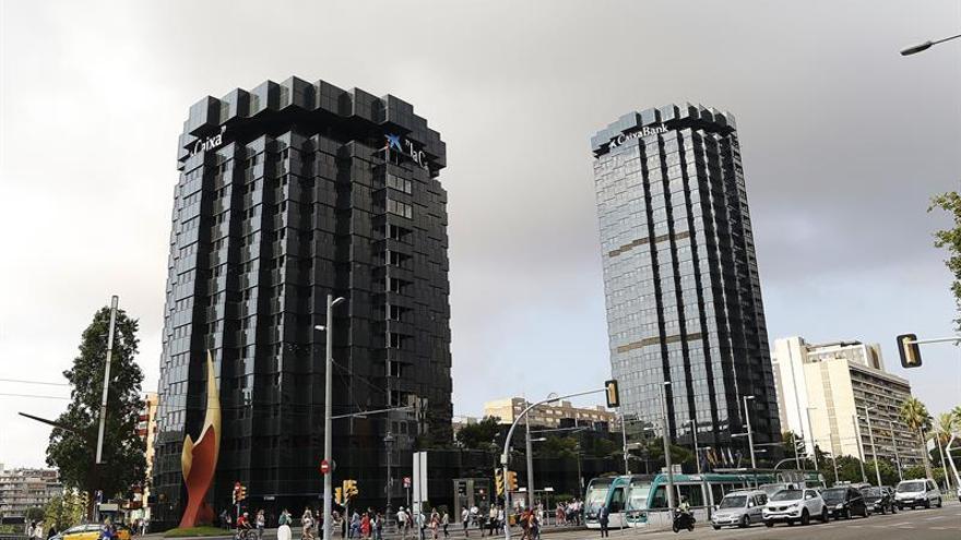 CaixaBank gana 839 millones, 31,6 % más, por BPI y mejora ingresos bancarios