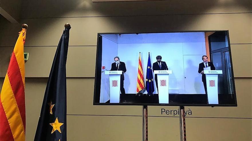 Los expresidentes Artur Mas, Carles Puigdemont y Quim Torra en rueda de prensa en la Casa de la Generalitat en Perpignan (Francia)