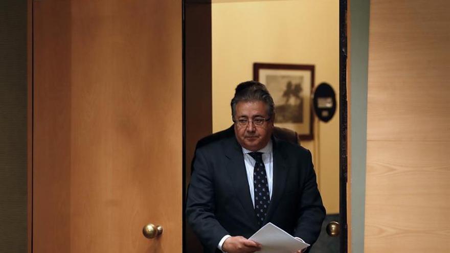 Zoido: Una investidura a distancia de Puigdemont sería ridiculizar a Cataluña