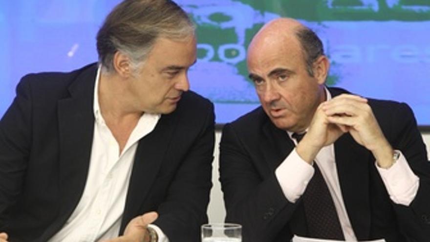 Pons y De Guindos en la sede del PP