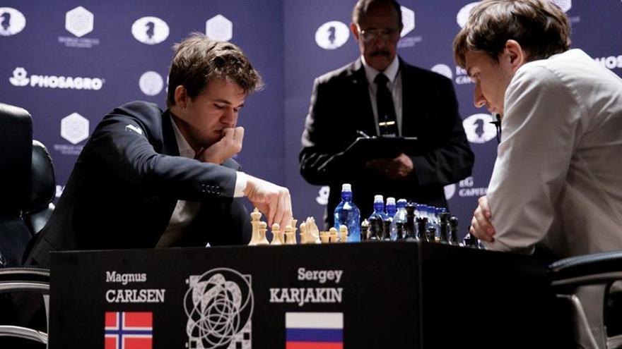 Carlsen gana la tercera partida de desempate y acaricia el título