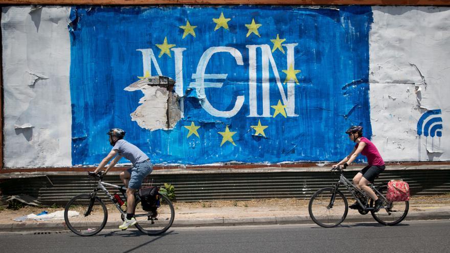 Un grafiti en Atenas juega con el Nein (no en alemán) y el Nai (sí en griego). Kay Nietfeld/dpa