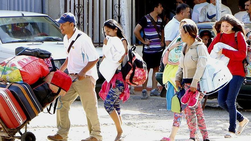 Un número creciente de venezolanos espera asilo en la frontera de México y EE.UU.