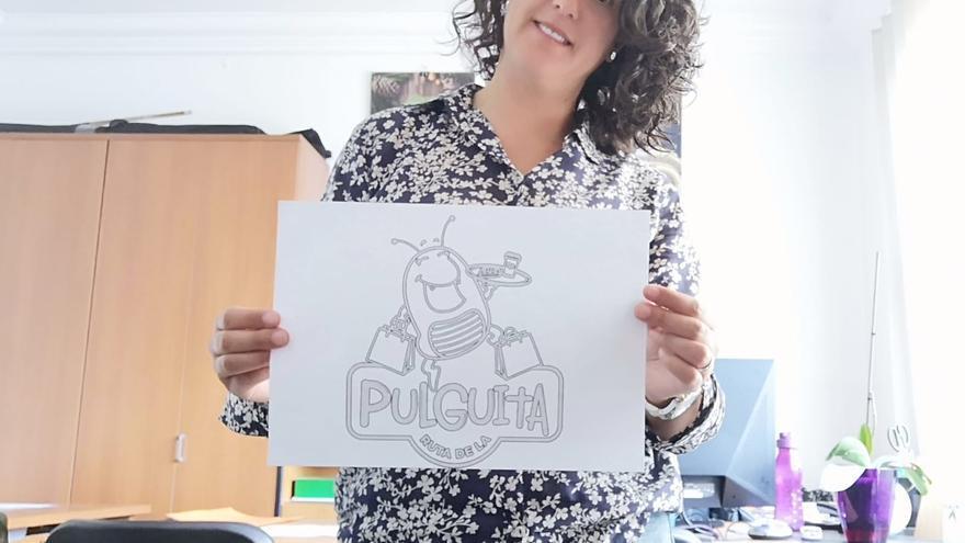 Eva G. Álvarez con el logo.