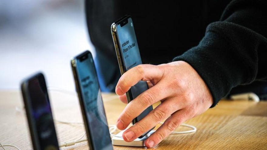 A customer checks the new iPhone 11 Pro Max on display at the Apple Store.