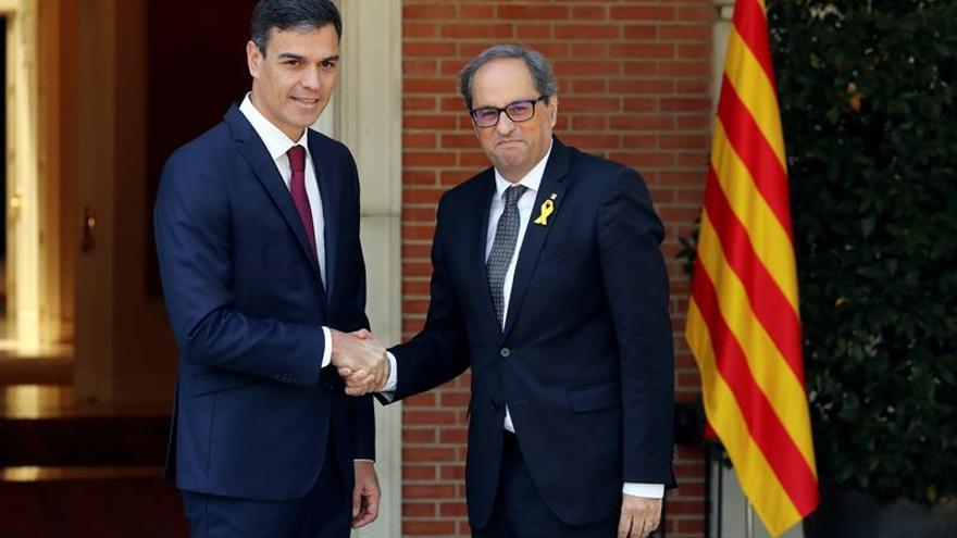 El presidente del Gobierno, Pedro Sánchez, y el president de la Generalitat, Quim Torra.