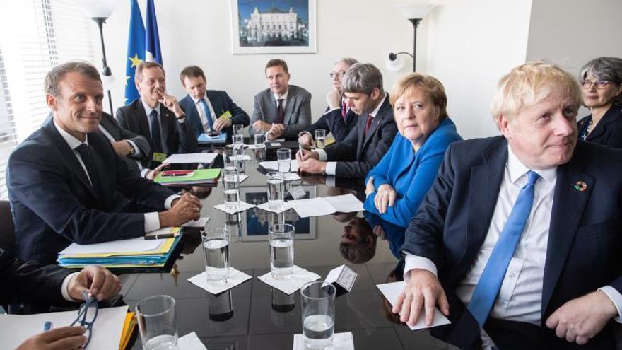 Emmanuel Macron, Angela Merkel y Boris Johnson.